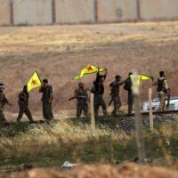 Turkey uneasy as increasingly powerful Kurds, with U.S. help, seize key Syria border town from Islamic State fighters