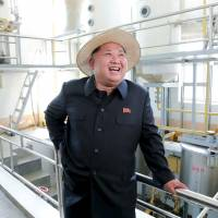 North Korean leader Kim Jong Un visits Farm No. 1116, under KPA (Korean People's Army) Unit 810, in this undated photo released by North Korea's Korean Central News Agency (KCNA) in Pyongyang on Monday. Outside his tightly controlled economy, his nation is seeing a rise in consumerism.   KNCA / REUTERS
