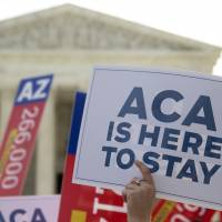 In key win for Obama, Supreme Court upholds main component of health care law