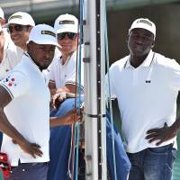 Migrants return to sea to race in sailing world championship