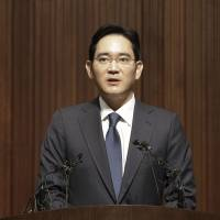 Samsung heir says sorry for failures at hospital where dozens of MERS infections occurred