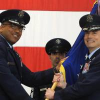 U.S. Air Force Brig. Gen. Paul W. Tibbets IV (right) receives the 509th Bomb Wing guidon from Maj. Gen. Richard Clark to take over leadership of the United States' aging fleet of nuclear-capable B-2 stealth bombers on Friday at Whiteman Air Force Base in Missouri. | AP