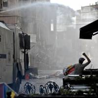 Turkish cops fire water cannon, pellets to end unauthorized gay pride parade
