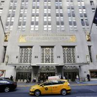 In this Oct. 6, 2014, file photo, a taxi passes in front of the fabled Waldorf Astoria hotel in New York. The State Department will abandon decades of tradition at the annual U.N. General Assembly this fall by setting up shop in a hotel other than New York's famed Waldorf-Astoria, which was purchased last year by a Chinese company. | AP