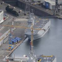 The two Mistral-class helicopter carriers Sevastopol (foreground) and Vladivostok are seen at the STX Les Chantiers de l'Atlantique shipyard site in Saint-Nazaire, France, on May 25.   REUTERS