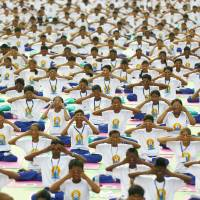Millions across India, globe bend and twist to world's first Yoga Day