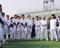 Team player: Shortly after creating the Sendai-based Tohoku Rakuten Golden Eagles baseball club in late 2004, Hiroshi Mikitani (left) visits its training camp at Fujiidera Baseball Stadium in Osaka.  | KYODO