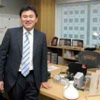 Going places: 'The biggest difference between Japan and the United States is that Americans believe from the bottom of their hearts that in order to develop their country's economy they have to start new industries,' says Hiroshi Mikitani, Rakuten Inc.'s founder, president and CEO, pictured in his Higashi-Shinagawa, Tokyo, office in mid March.  | YOSHIAKI MIURA