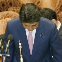 Prime Minister Shinzo Abe apologizes Monday for jeering an opposition lawmaker during a Diet session last week. | KYODO