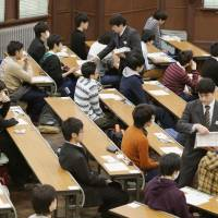 Students take the National Center Test for University Admissions at the University of Tokyo in January 2014. | KYODO