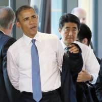 U.S. President Barack Obama and Prime Minister Shinzo Abe head to a working session of the Group of Seven summit in Germany on Sunday after posing for a group photo. | AFP-JIJI