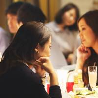 Women dine at a bar in Tokyo last September. The 2015 White Paper on Gender Equality released Friday says that the government's goal of boosting the ratio of women in leadership positions in every field to 30 percent by 2020 is looking increasingly unrealistic. | BLOOMBERG
