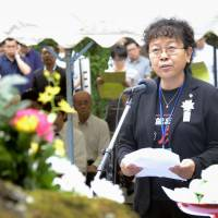 Wang Jingxin of China, whose father was a wartime forced laborer at the Hanaoka mining camp in Odate, Akita Prefecture, speaks at a ceremony Tuesday marking the 70th anniversary of an uprising there. | KYODO