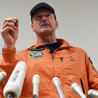 Solar Impulse 2 pilot Andre Borschberg speaks to journalists after he landed at Nagoya airport Monday night. | AFP-JIJI
