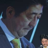 Prime Minister Shinzo Abe faces another headache after members of his party called for punishing the media for critical reporting on the national security bills. | BLOOMBERG