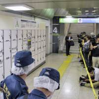 Woman's body found in suitcase after spending month in Tokyo Station