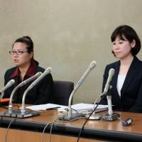 Yukari Nishihara (left) and Tomoko Toyoda speak of the ordeals they suffered after telling their employers that they were pregnant, in Tokyo on Wednesday. | TOMOHIRO OSAKI
