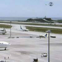 A screen grab of an NHK news program aired Wednesday shows a runway mishap at Naha Airport in Okinawa Prefecture earlier in the day that involved two civilian airplanes (1)(3) and an Air Self-Defense Force chopper (2). | NHK / KYODO