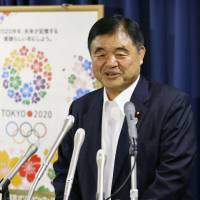 Toshiaki Endo, the newly appointed minister in charge of the 2020 Tokyo Olympics, speaks at his inaugural news conference at the Cabinet Office on Thursday. | KYODO