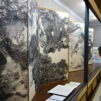 A visitor looks at 'Death of American Prisoners of War,' one of 15 large folding-screen panels on the U.S. atomic bombings drawn by Iri and Toshi Maruki, at the Maruki Gallery for the Hiroshima Panels in Higashimatsuyama, Saitama Prefecture, on May 31. | KYODO
