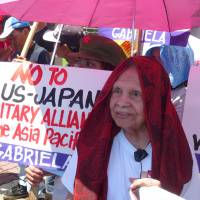 Hilaria Bustamante, 89, a victim of Japanese military wartime sex abuses in the Philippines, joins a protest on June 23 in front of the Japanese Embassy in Manila. | KYODO