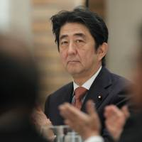 Prime Minister Shinzo Abe attends the International Conference on The Future of Asia in Tokyo on May 21. Japan and the Asian Development Bank plan to boost funding for what they term high-quality infrastructure projects in Asia to about $110 billion over the next five years. Abe is said to be in a bind over his hopes to realize a visit by Russian President Vladimir Putin this year and keeping Russia under sanctions from drawing closer to an ever-assertive China. | BLOOMBERG