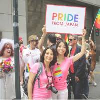 Koyuki Higashi (right) and her partner Hiroko Masuhara join a parade in New York on Sunday celebrating the Supreme Court decision to recognize gay marriages in all U.S. states. | KYODO