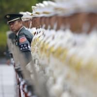 Members of a Self-Defense Force honor guard prepare for a ceremony to mark the arrival of Australian Defense Minister Kevin Andrews at the Defense Ministry in Tokyo on Wednesday. | REUTERS