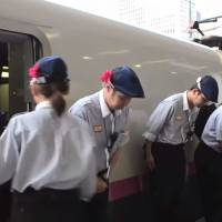 A video titled '7-Minute Miracle' produced by American journalist Charli James shows workers lining up and bowing after cleaning the interior of a bullet train in Tokyo Station. | YOUTUBE