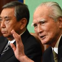 Former Prime Minister Tomiichi Murayama (right) answers questions with former Deputy Prime Minister Yohei Kono during a joint news conference at the Japan National Press Club in Tokyo on Tuesday. | AFP-JIJI