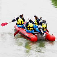 Police and firefighters search Monday for a 15-year-old boy who presumably drowned after being beaten and forced into the Aizuma River in Kariya, Aichi Prefecture.   KYODO