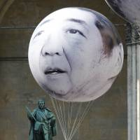 A balloon made by antipoverty advocacy One depicts Prime Minister Shinzo Abe in Munich on Friday. Abe is visiting Ukraine on his way to the Group of Seven summit in Germany. | REUTERS