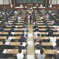 Students take the entrance exam for the University of Tokyo in February. | KYODO