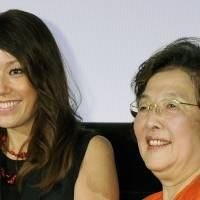 TV celebrity and film presenter  Lilico (left) poses with translator Natsuko Toda at a movie event in 2011. | KYODO