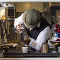 Pour soul: Shingo Naganuma carefully creates his signature drip coffee at Nejimakigumo. | JAMES HADFIELD