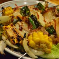 Messy feast: One of the signature dishes at Isaribi is skewers loaded with corn, bacon and chicken. | J.J. O'DONOGHUE