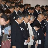 Niigata Minamata victims observe a minute's silence on May 31 during a memorial event to mark the 50th anniversary of the disease. | ROB GILHOOLY