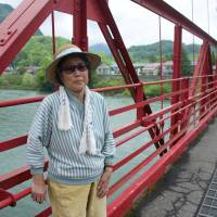 Fumiko Hatano, 79, stands on a bridge that spans the Agano River at Kanose in Niigata Prefecture on May 31. | ROB GILHOOLY