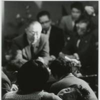 Tomoko Uemura is held by her mother as Minamata victims and their families meet the chief of the Environment Agency in 1972. Aileen M. Smith and her husband, Eugene, documented the Minamata outbreaks in Kyushu and Niigata in the 1970s. | W. EUGENE SMITH AND AILEEN M. SMITH