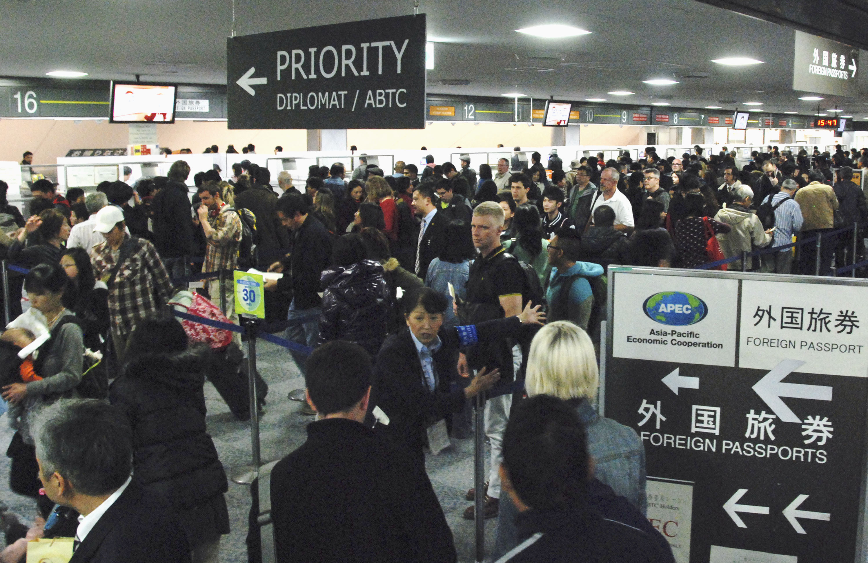 Japans masochistic approach to immigration the japan times guiding lines a group of travelers arrives at the immigration section of narita international airport stopboris Image collections