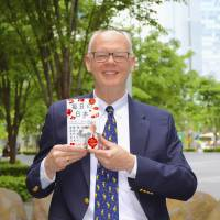 An incurable curiosity: Researcher James M. Vardaman with his newest publication, 'Everything Nippon: Talking about Everyday Japan in English!'    MATTHEW CHOZICK