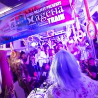 Tight squeeze: Passengers crowd around the DJ booth in car No. 9. The ageHa Train, a collaboration between the nightclub ageHa and Seibu Railway, proved that with some strobe lights and bass, the train isn't always so miserable.