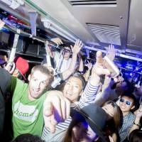 Jump up: Clubbers crowd together on the ageHa Train on Saturday night. Despite the rush-hour-like squeeze and sudden jolts during the journey, everyone  did their best to dance.