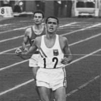 Ron Clarke, seen here winning the qualifying heat in the men's 5,000 meters as the 1964 Tokyo Olympics, lit the Olympic flame at the 1956 Melbourne Games. He later served as mayor of Gold Coast, Australia. | PHOTO COURTESY OF TRACK & FIELD NEWS (USA)