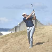 Spieth, Reed share U.S. Open lead