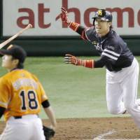 Fukuoka Softbank's Hiroaki Takaya hits a two-run double in the fourth inning of the Hawks' 3-2 win over the Giants at Tokyo Dome on Saturday. | KYODO