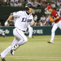 Shogo Akiyama sprints to first base en route to a two-run double in the eighth inning against the Carp at Seibu Prince Dome on Tuesday. Siebu defeated Hiroshima 4-2. | KYODO