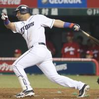The Lions' Ernesto Mejia hits a game-winning single in the ninth inning against the Carp on Thursday at Seibu Prince Dome. Seibu beat Hiroshima 5-4. | KYODO