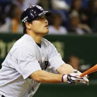 The Dragons' Ryosuke Hirata belts a three-run home run in the 10th inning against the Giants on Friday night at Tokyo Dome. Chunichi defeated Yomiuri 8-5.   KYODO