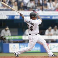 The Marines' Alfredo Despaigne bashes a third-inning home run against the Buffaloes on Saturday at QVC Marine Field. Despaigne had three hits in Chiba Lotte's 12-3 rout of Orix. | KYODO